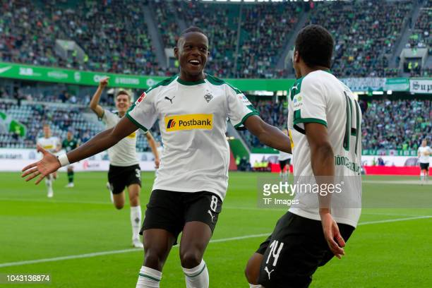 Alassane Plea of Borussia Moenchengladbach celebrates after scoring his team`s first goal with team mates during the Bundesliga match between VfL...