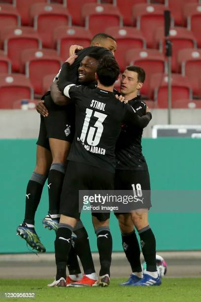 Alassane Plea of Borussia Moenchengladbach celebrates after scoring his team's second goal with teammates during the DFB Cup Round of Sixteen match...