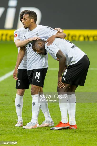 Alassane Plea of Borussia Moenchengladbach celebrates after scoring his team's first goal with teammates during the Bundesliga match between TSG...