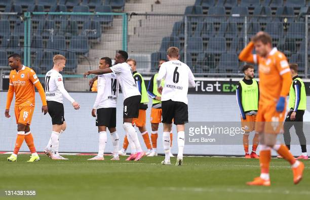 Alassane Plea of Borussia Moenchengladbach celebrates after scoring their team's fifth goal with Hannes Wolf and Denis Zakaria during the Bundesliga...