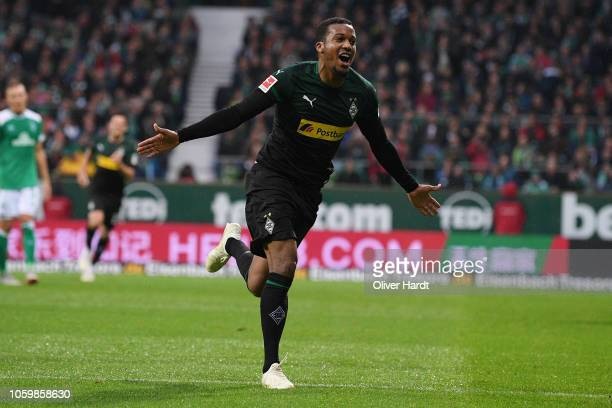 Alassane Plea of Borussia Moenchengladbach celebrates with after scoring their first goal during the Bundesliga match between SV Werder Bremen and...