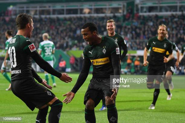 Alassane Plea of Borussia Moenchengladbach celebrates with after scoring their second goal during the Bundesliga match between SV Werder Bremen and...