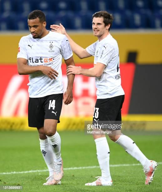 Alassane Plea of Borussia Moenchengladbach celebrates with Jonas Hofmann after scoring their side's first goal during the Bundesliga match between...