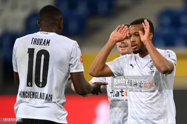 Alassane Plea of Borussia Moenchengladbach celebrates with Marcus Thuram after scoring their side's first goal during the Bundesliga match between...