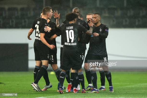 Alassane Plea of Borussia Moenchengladbach celebrates with Valentino Lazaro, Matthias Ginter and Tony Jantschke after scoring their team's first goal...