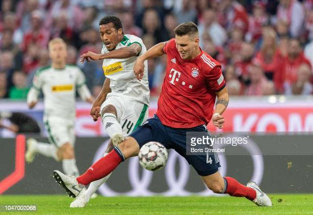 Alassane Plea of Borussia Moenchengladbach scores his team's first goal during the Bundesliga match between FC Bayern Muenchen and Borussia...