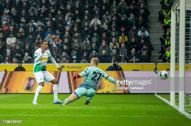 Alassane Plea of Borussia Moenchengladbach scores his teams first goal during the Bundesliga match between Borussia Moenchengladbach and 1.FSV Mainz...