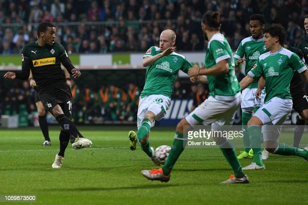 Alassane Plea of Borussia Moenchengladbach scores his team's second goal during the Bundesliga match between SV Werder Bremen and Borussia...