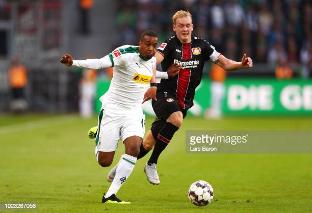 Alassane Plea of Borussia Monchengladbach battles for posession with Julian Brandt of Bayer Leverkusen during the Bundesliga match between Borussia...