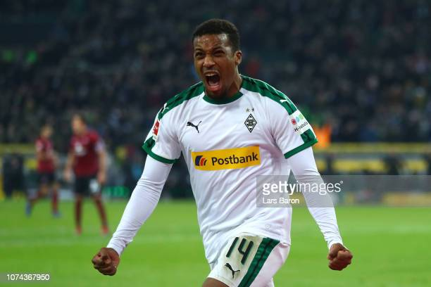 Alassane Plea of Borussia Monchengladbach celebrates after he scores his sides second goal during the Bundesliga match between Borussia...