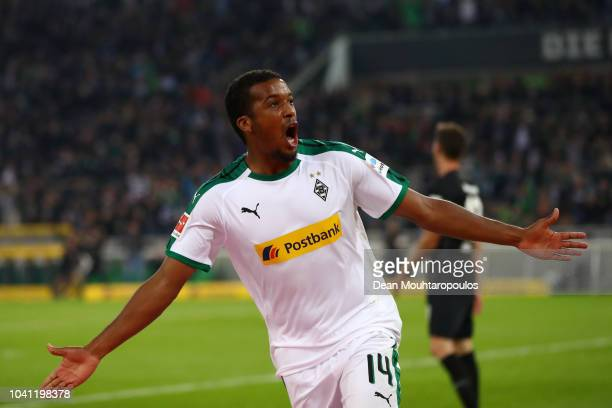 Alassane Plea of Borussia Monchengladbach celebrates after scoring his team's first goal during the Bundesliga match between Borussia...