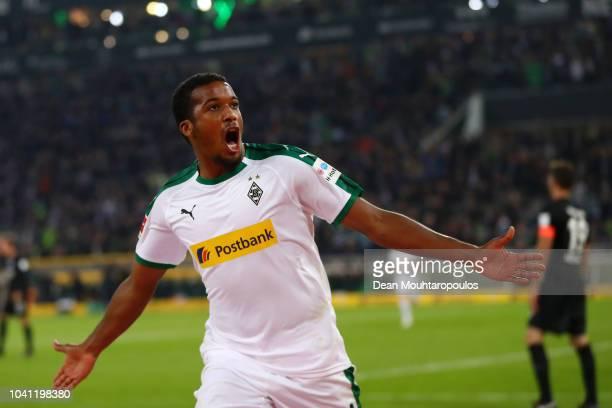 Alassane Plea of Borussia Monchengladbach celebrates after scoring his team's first goal during the Bundesliga match between Borussia...