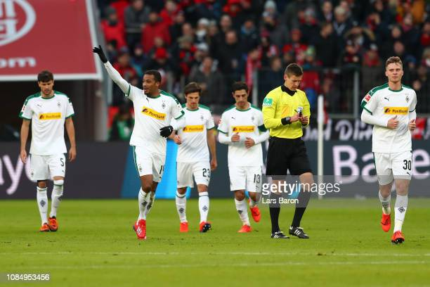 Alassane Plea of Borussia Monchengladbach celebrates after scoring his sides first goal during the Bundesliga match between Bayer 04 Leverkusen and...