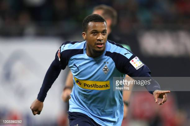 Alassane Plea of Borussia Monchengladbach celebrates after scoring his sides first goal during the Bundesliga match between RB Leipzig and Borussia...