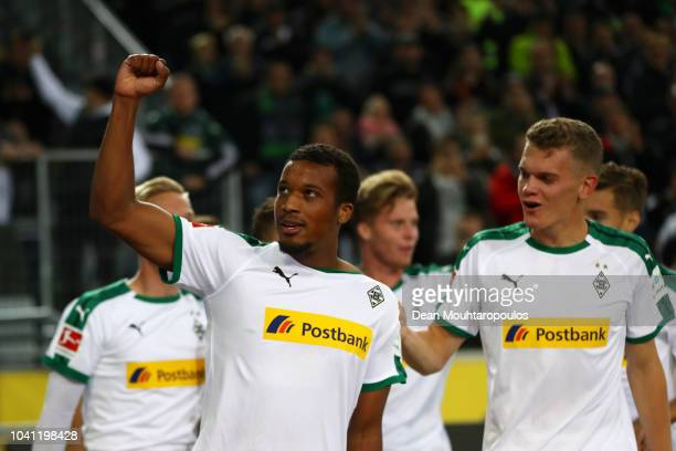 Alassane Plea of Borussia Monchengladbach celebrates with team mates after scoring his team's first goal during the Bundesliga match between Borussia...