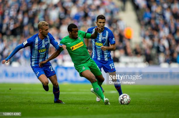 Alassane Plea of Borussia Monchengladbach is chased by Fabian Lustenberger of Hertha BSC during the Bundesliga match between Hertha BSC and Borussia...