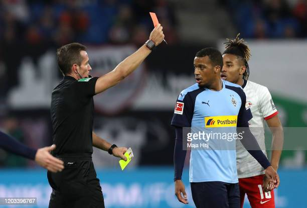 Alassane Plea of Borussia Monchengladbach is shown a red card and sent off during the Bundesliga match between RB Leipzig and Borussia...