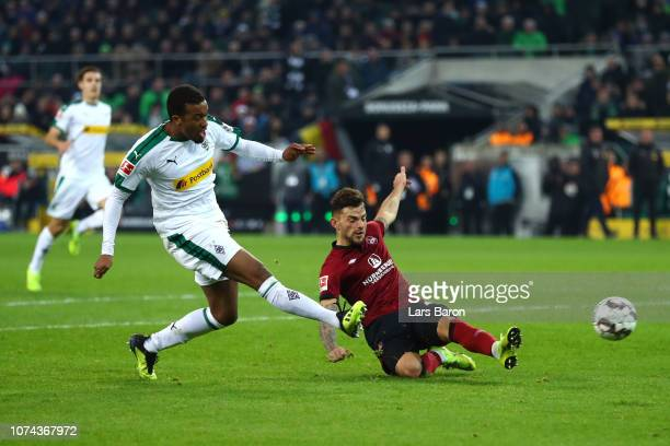 Alassane Plea of Borussia Monchengladbach scores his sides second goal during the Bundesliga match between Borussia Moenchengladbach and 1. FC...