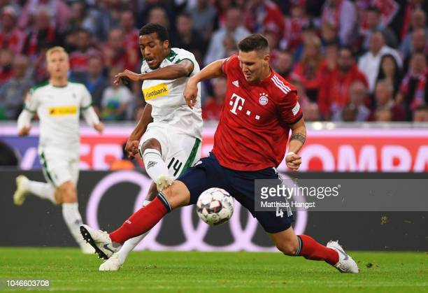 Alassane Plea of Borussia Monchengladbach scores his team's first goal during the Bundesliga match between FC Bayern Muenchen and Borussia...