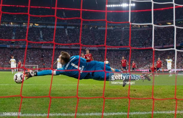 Alassane Plea of Borussia Monchengladbach scores his team's first goal past Goalkeeper Manuel Neuer of FC Bayern Muenchen during the Bundesliga match...