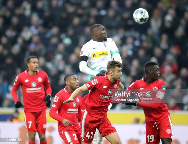 Alassane Plea of Borussia Monchengladbach scores his team's first goal during the Bundesliga match between Borussia Moenchengladbach and 1. FSV Mainz...
