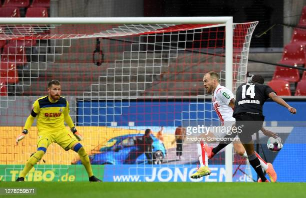 Alassane Plea of Borussia Monchengladbach scores his team's first goal during the Bundesliga match between 1. FC Koeln and Borussia Moenchengladbach...