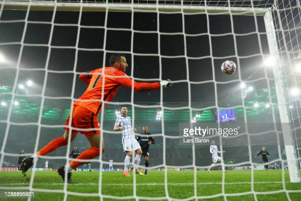 Alassane Plea of Borussia Monchengladbach scores his team's first goal past Samir Handanovic of Inter Milan during the UEFA Champions League Group B...