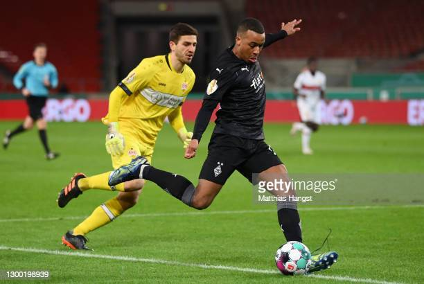 Alassane Plea of Borussia Monchengladbach scores his team's second goal during the DFB Cup Round of Sixteen match between VfB Stuttgart and Borussia...