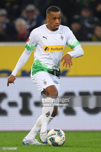 Alassane Plea of Moenchengladbach controls the ball during the Bundesliga match between Borussia Moenchengladbach and Borussia Dortmund at...