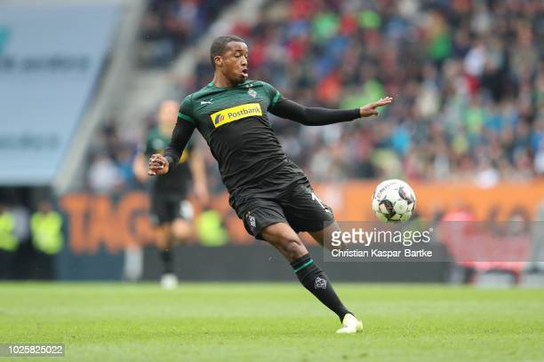 Alassane Plea of Moenchengladbach in action during the Bundesliga match between FC Augsburg and Borussia Moenchengladbach at WWKArena on September 1...