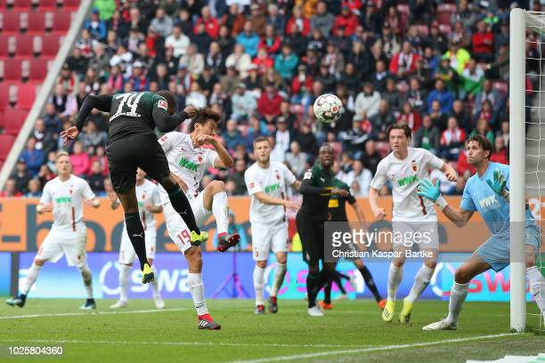Alassane Plea of Moenchengladbach scores the first goal for Moenchengladbach during the Bundesliga match between FC Augsburg and Borussia...