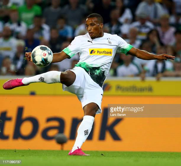 Alassane Plea of Moenchengladbach shoots on goal during the Bundesliga match between Borussia Moenchengladbach and RB Leipzig at Borussia-Park on...