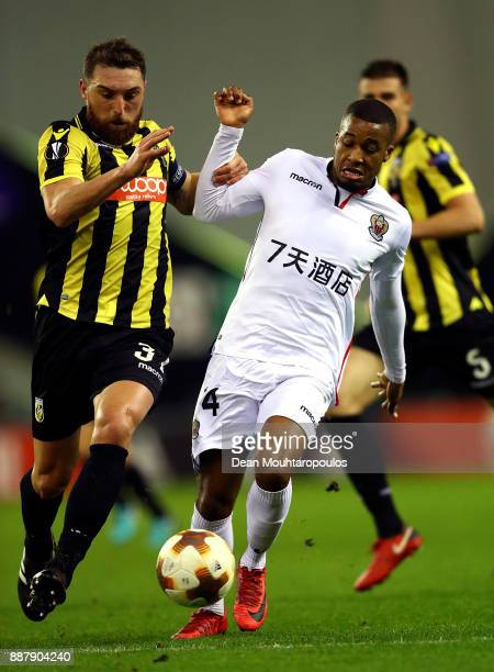 Alassane Plea of Nice holds off pressure from Guram Kashia of Vitesse during the UEFA Europa League group K match between Vitesse and OGC Nice on...