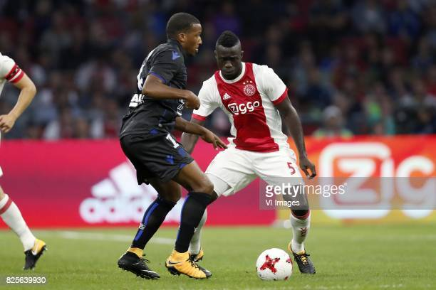 Alassane Plea of OCG Nice Davinson Sanchez of Ajax during the UEFA Champions League third round qualifying first leg match between Ajax Amsterdam and...