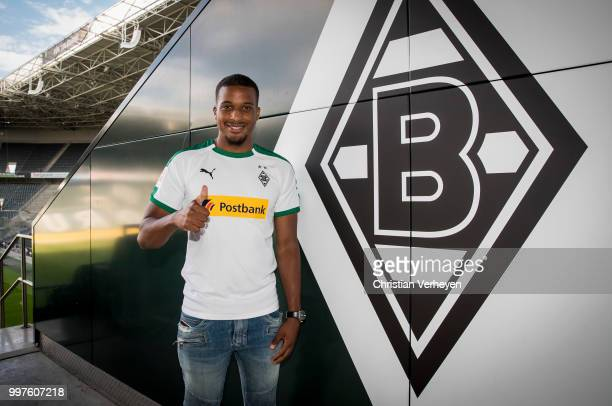 Alassane Plea pose with his new shirt after he signs a new contract for Borussia Moenchengladbach at BorussiaPark on July 12 2018 in Moenchengladbach...