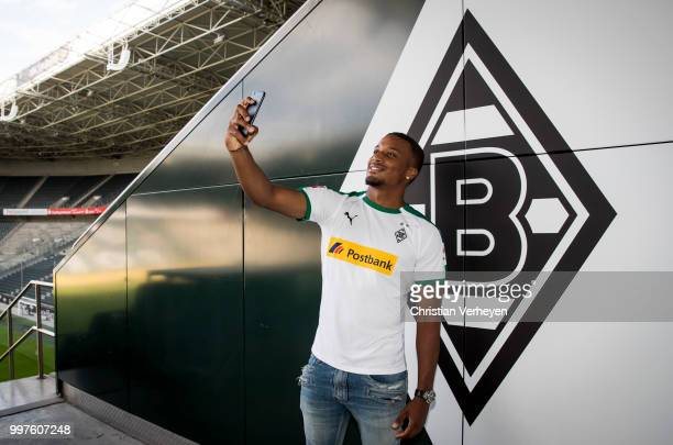 Alassane Plea take a selfie in his new shirt after he signs a new contract for Borussia Moenchengladbach at BorussiaPark on July 12 2018 in...