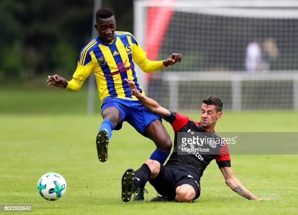 Alassane Sama of Buxtehude and Jan Philipp Kalla of St Pauli battle for the ball during the preseason friendly match between Buxtehuder SV and FC St...