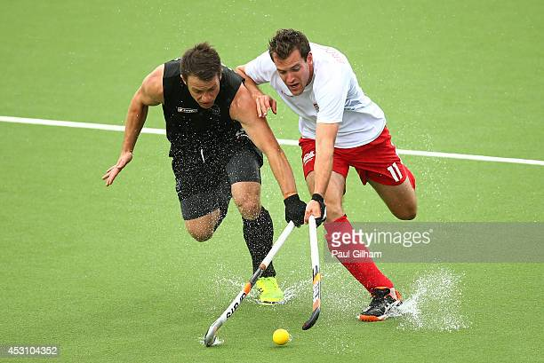 Alastair Brogdon of England and Shea McAleese of New Zealand battle for the ball in the bronze medal match between New Zealand and England at Glasgow...