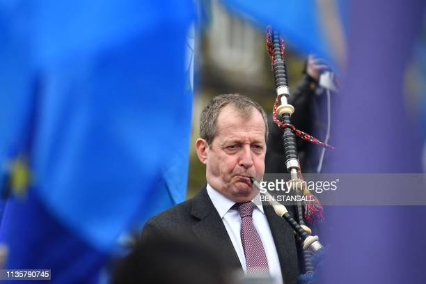 Alastair Campbell former director of communications for Tony Blair plays the bagpipes as he demonstrates outside the Houses of Parliament in central...