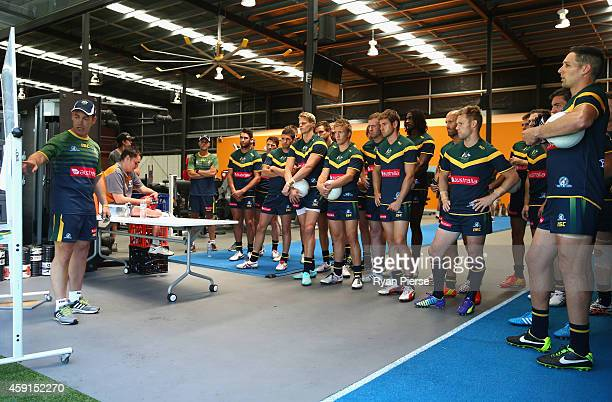 Alastair Clarkson coach of Australia addresses his players before the International Rules practice match between Australia and the NSW Gaelic...