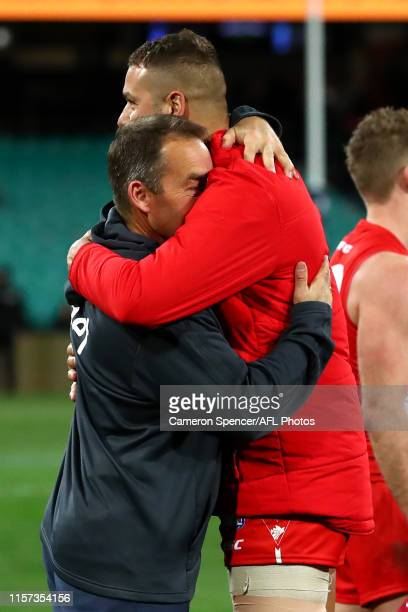 Alastair Clarkson coach of the Hawks embraces Lance Franklin of the Swans following the round 14 AFL match between the Sydney Swans and the Hawthorn...