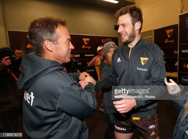 Alastair Clarkson, Senior Coach of the Hawks and Grant Birchall of the Hawks celebrate during the 2019 AFL round 17 match between the Hawthorn Hawks...