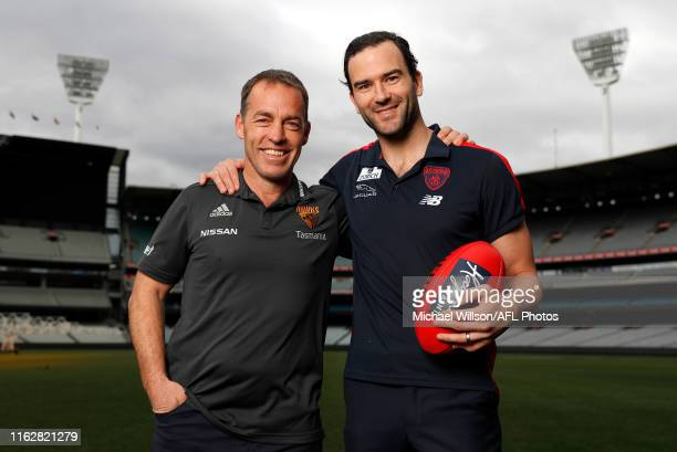 Alastair Clarkson Senior Coach of the Hawks and Jordan Lewis pose for a photograph after announcing his AFL retirement during a press conference at...