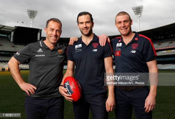 Alastair Clarkson Senior Coach of the Hawks Jordan Lewis and Simon Goodwin Senior Coach of the Demons pose for a photograph after Lewis announced his...