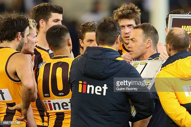 Alastair Clarkson the coach of the Hawks talks to his players during the round 23 AFL match between the Hawthorn Hawks and the Carlton Blues at...