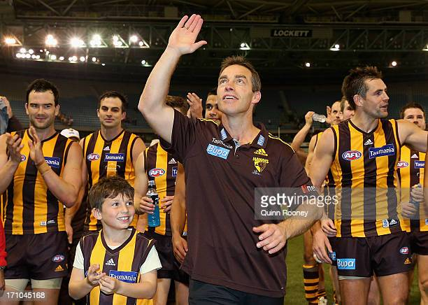 Alastair Clarkson the coach of the Hawks waves to the fans after coaching his 200th game during the round 13 AFL match between the Hawthorn Hawks and...