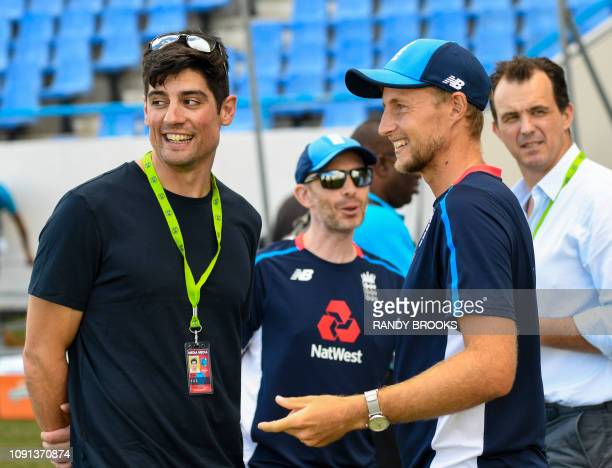 Alastair Cook and Joe Root of England chat during a training session one day ahead of the 2nd Test between West Indies and England at Vivian Richards...