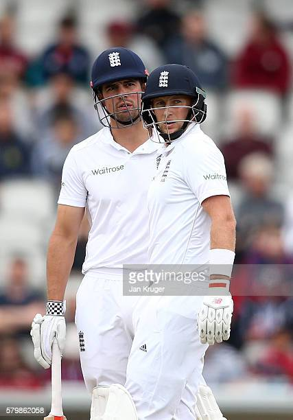 Alastair Cook and Joe Root of England looks on during day four of the 2nd Investec Test between England and Pakistan at Old Trafford on July 25 2016...