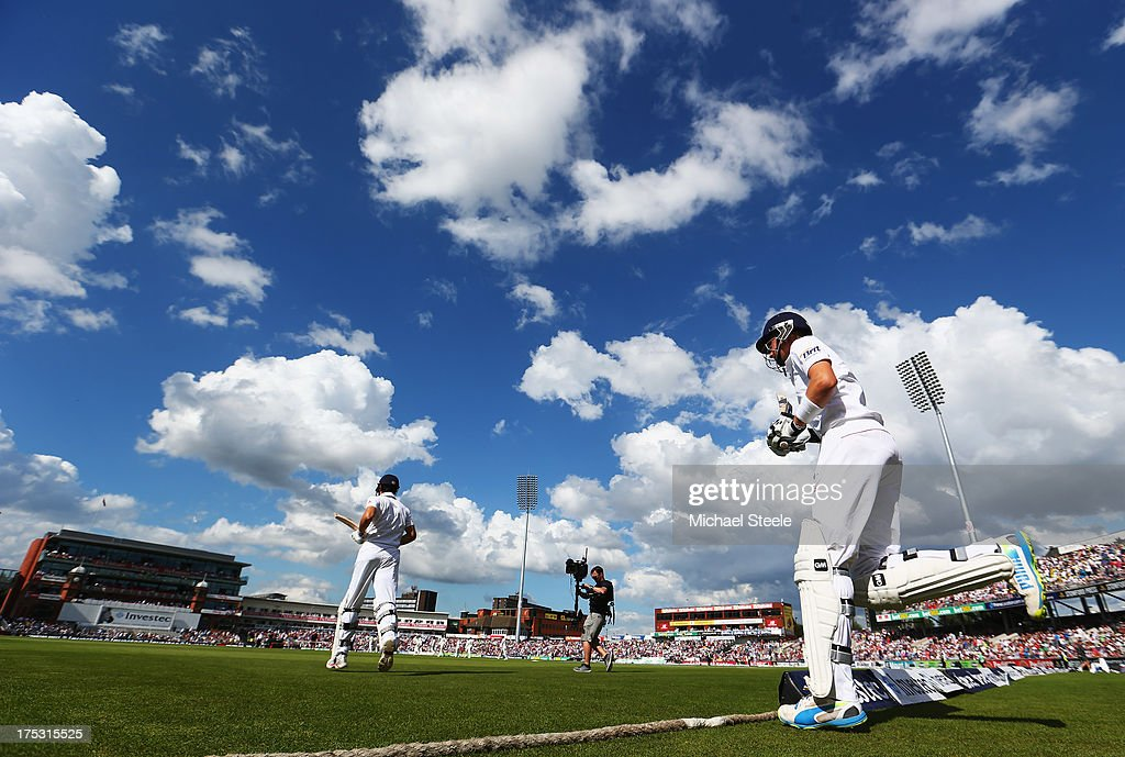 Alastair Cook (L) and Joe Root of England walk out to open the innings during day two of the 3rd Investec Ashes Test match between England and Australia at Emirates Old Trafford Cricket Ground on August 2, 2013 in Manchester, England.
