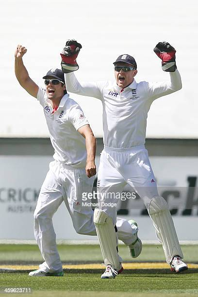 Alastair Cook and Jonny Bairstow of England celebrate the dismissal of David Warner during day four of the Fourth Ashes Test Match between Australia...